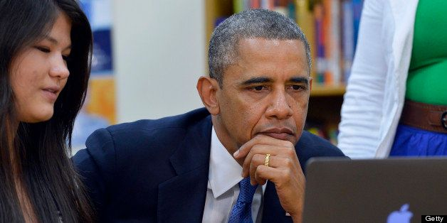 US President Barack Obama listens to student as he tours Mooresville Middle School in Mooresville, North Carolina, on June 6,