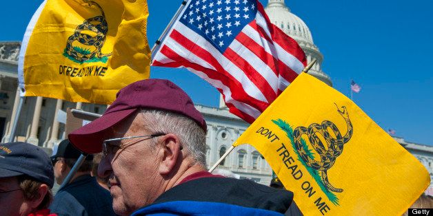UNITED STATES Ð APRIL 6: Tea party activist on the East Front of the U.S. Capitol hold up signs and flags during a rally on W