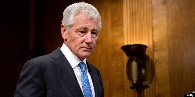 US Defense Secretary Chuck Hagel arrives to testify at a Senate Budget Committee hearing on 'The President's FY2014 Defense B