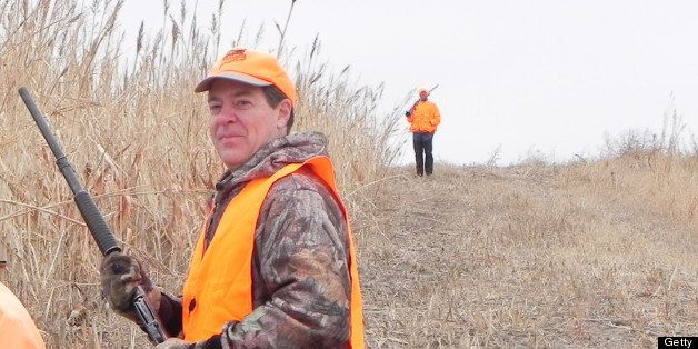 Kansas Gov. Sam Brownback, right, and guide Troy Sporer waited for other hunters before heading into cover during the Kansas