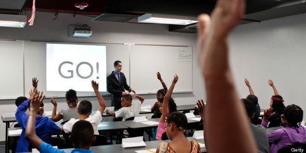 WASHINGTON, DC - AUGUST 13:Math teacher Robert Biemesderfer asks students questions during the opening of a BASIS charter school, a brand that has been called one of the most challenging high schools in the country at a boot camp type program where students will begin to learn all of the behaviors that are expected of them at the school, as well as continue to catch up academically so that they can start the ultra-rigorous regular curriculum the following week in Washington, DC on Monday August 13, 2012. (Photo by Jabin Botsford/For The Washington Post via Getty Images)