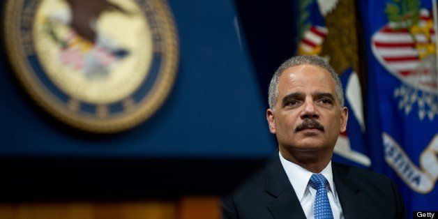 US Attorney General Eric Holder waits to address the Justice Department's Lesbian, Gay, Bisexual and Transgender (LGBT) Pride