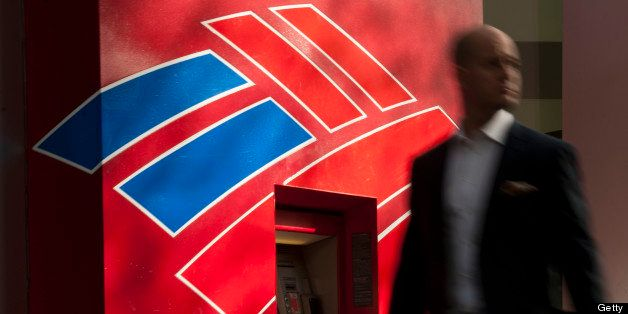 A man walks past a Bank of America Corp. automated teller machine (ATM) in Charlotte, North Carolina, U.S., on Wednesday, May