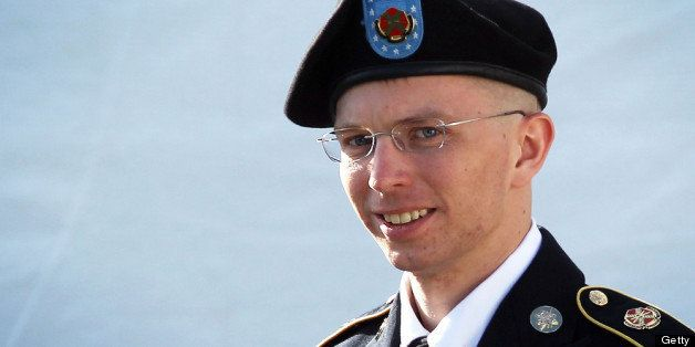FORT MEADE, MD - JUNE 06:  U.S. Army Private Bradley Manning is escorted as he leaves a military court at the end of the firs