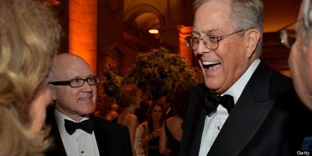 David Koch, executive vice president of chemical technology for Koch Industries Inc., right, speaks with Robert 'Woody' Johns