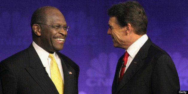 ROCHESTER, MI - NOVEMBER 09:  Republican presidential candidates businessman Herman Cain (L) and Texas Governor Rick Perry ch