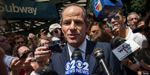 NEW YORK, NY - JULY 08:  Former New York Gov. Eliot Spitzer is mobbed by reporters while attempting to collect signatures to run for comptroller of New York City on July 8, 2013 in New York City. Spitzer resigned as governor in 2008 after it was discovered that he was using a high end call girl service.  (Photo by Andrew Burton/Getty Images)