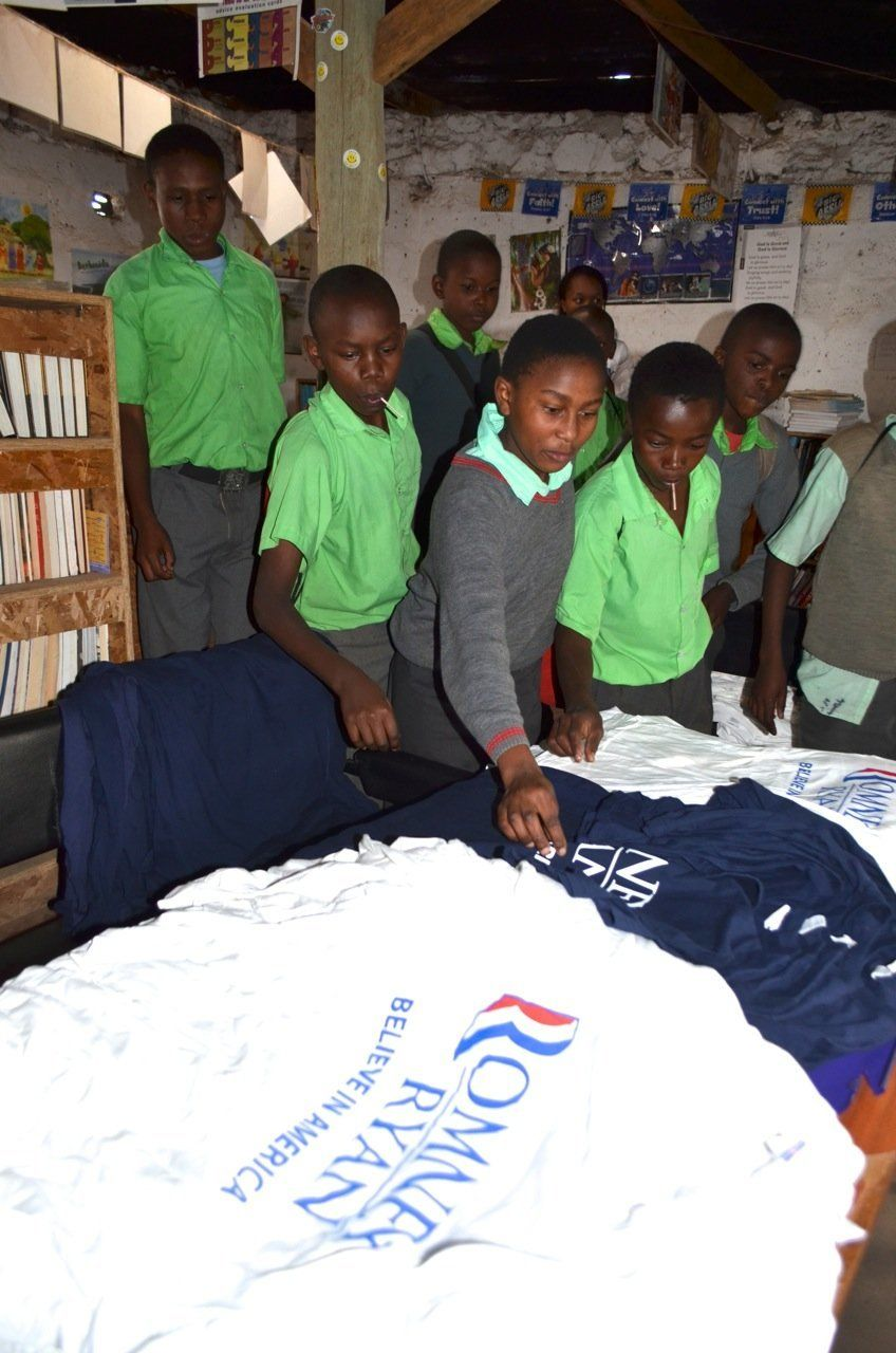 """Children in a refuge run by <a href=""""www.orbitvillage.com"""" target=""""_blank"""">Orbit Village</a> in Kenya pick out shirts donated"""
