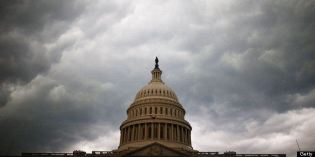 WASHINGTON, DC - JUNE 13:  Storm clouds fill the sky over the U.S. Capitol Building, June 13, 2013 in Washington, DC. Potenti