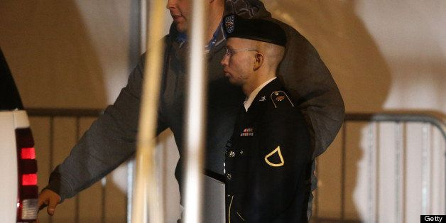 FORT MEADE, MD - FEBRUARY 28:  Pfc. Bradley E. Manning is escorted from a hearing, on February 28, 2013 in Fort Meade, Maryla