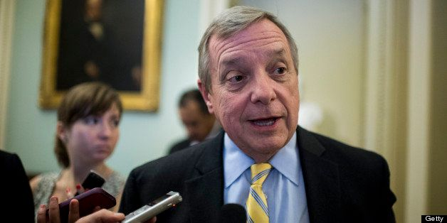 UNITED STATES - JULY 11: Sen. Richard Durbin, D-Ill., speaks with reporters as he arrives for the Senate Democrats' caucus lu