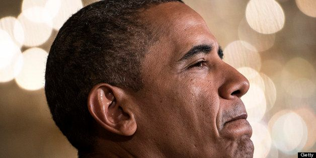 US President Barack Obama pauses while making a statement in the East Room of the White House on July 18, 2013 in Washington,