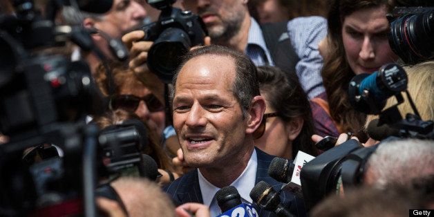 NEW YORK, NY - JULY 08:  Former New York Gov. Eliot Spitzer is mobbed by reporters while attempting to collect signatures to