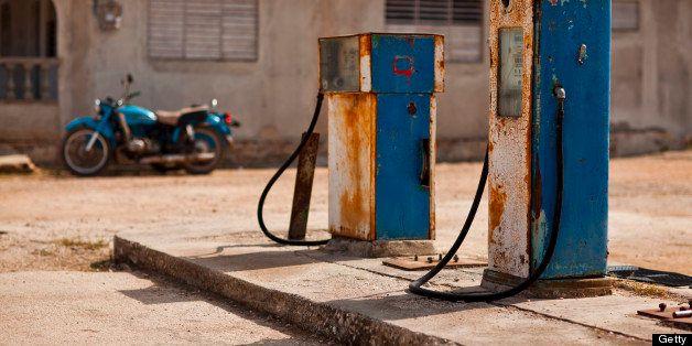 Old petrol pump on lot