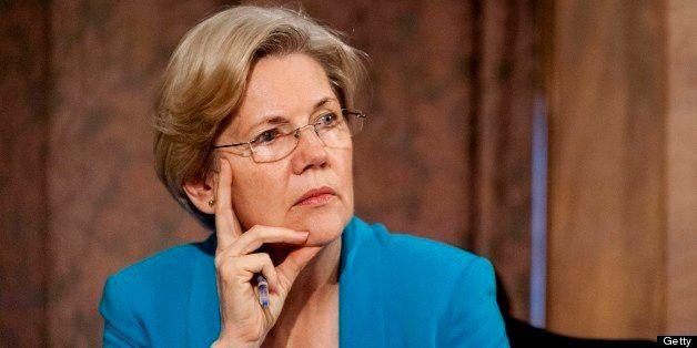 Senator Elizabeth Warren, a Democrat from Massachusetts, listens as Ben S. Bernanke, chairman of the U.S. Federal Reserve, no