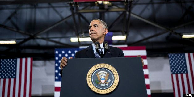 US President Barack Obama pauses while speaking at Knox College July 24, 2013 in Galesburg, Illinois. Obama is traveling to I