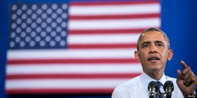 US President Barack Obama speaks at University of Central Missouri July 24, 2013 in Missouri. Obama traveled to Illinois and