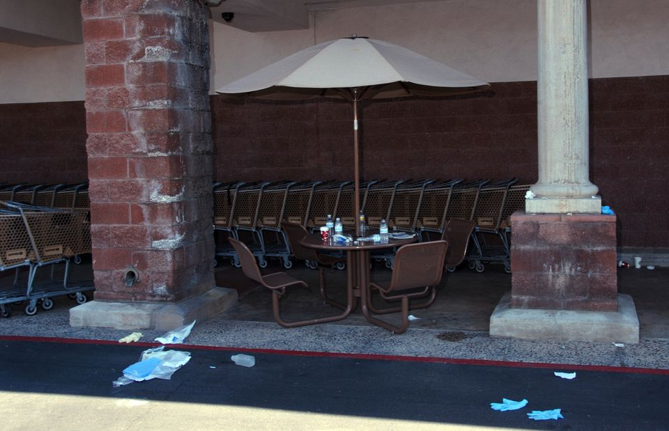 In this image released by the Pima County Sheriff's department, medical gloves and other debris are seen near a lunch table o