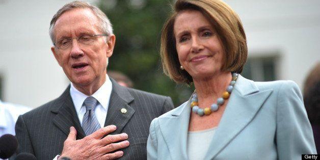 Senate Majority Leader Harry Reid, D-NV, speaks to reporters as House Speaker Nancy Pelosi, D-CA, looks on in front of the We