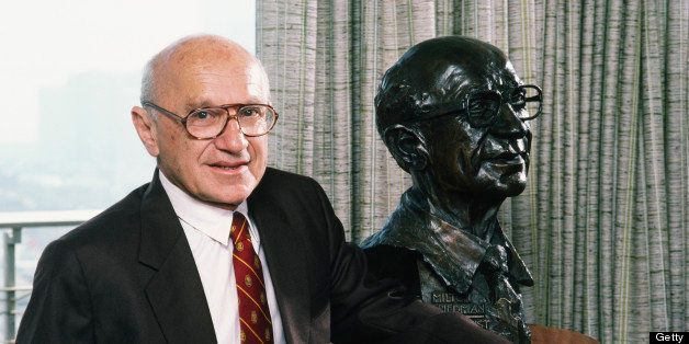 SAN FRANCISCO, CA - 1986:  Nobel Prize-winning economist Milton Friedman poses with a sculpture of himself during a 1986 San