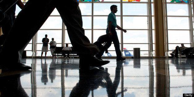 ARLINGTON, VA - AUGUST 2: Travelers walk through the concourse of Ronald Reagan Washington National Airport in  Arlington, VA