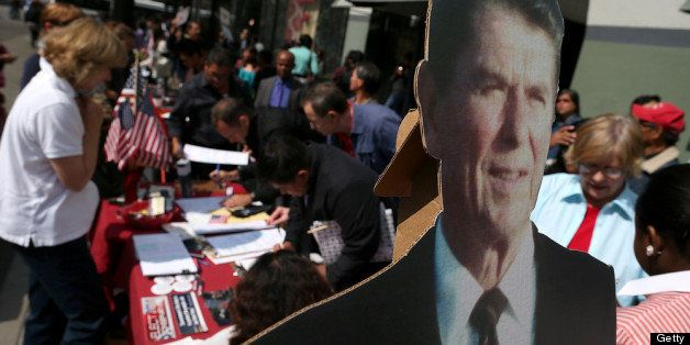 OAKLAND, CA - JULY 30:  A cardboard cutout of former U.S. President Ronald Reagan is displayed as newly sworn in U.S. citizen