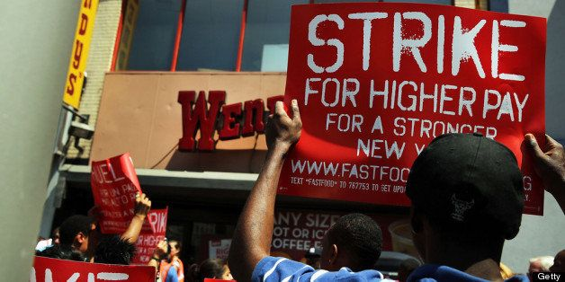 NEW YORK, NY - JULY 29: Employees and supporters demonstrate outside of a Wendy's fast-food restaurant to demand higher pay a