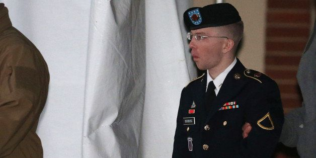 WASHINGTON, DC - JANUARY 08:  Pfc. Bradley E. Manning is escorted from a hearing, on January 8, 2013 in Fort Meade, Maryland.