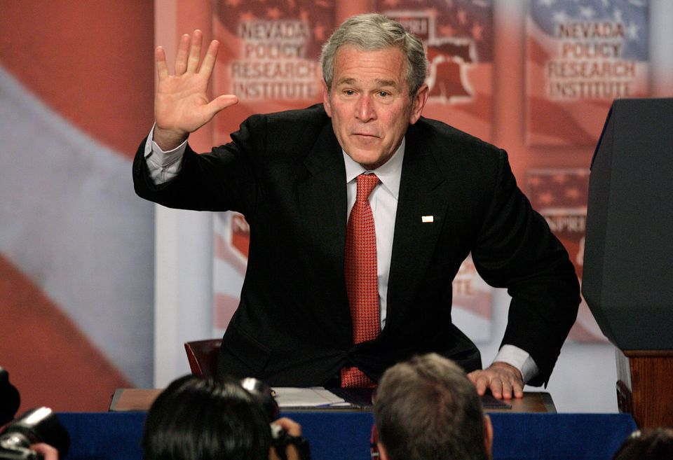 FILE - In this Jan. 31, 2008, file photo President Bush waves after signing a 15-day extension of the Protect America Act aft