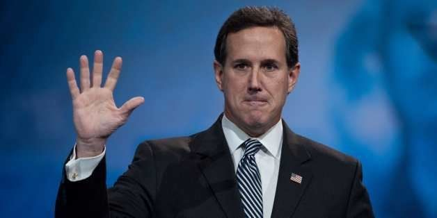 Former US Republican Senator from Pennsylvania Rick Santorum waves after speaking at the Conservative Political Action Confer