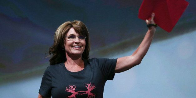 HOUSTON, TX - MAY 03:  Former Alaska Gov. Sarah Palin waves before speaking during the 2013 NRA Annual Meeting and Exhibits a