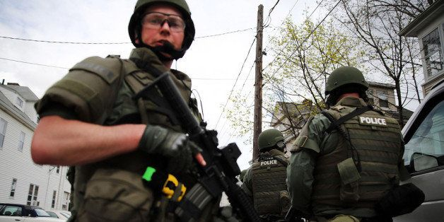 WATERTOWN, MA - APRIL 19:  Members of a police SWAT team conduct a door-to-door search for 19-year-old Boston Marathon bombin