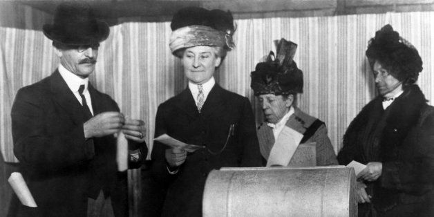 Three unidentified women make history by becoming the first of their sex to vote in an election after the 19th Amendment was
