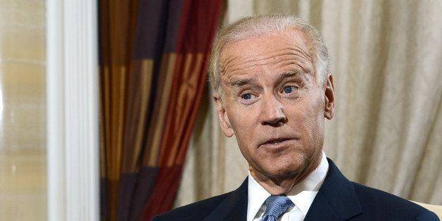 U.S. Vice President Joseph 'Joe' Biden gestures as he speaks during an interview in Singapore, on Saturday, July 27, 2013. Bi