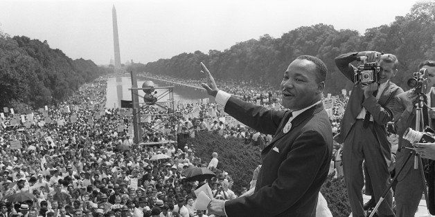 WASHINGTON, UNITED STATES:  The civil rights leader Martin Luther KIng (C) waves to supporters 28 August 1963 on the Mall in