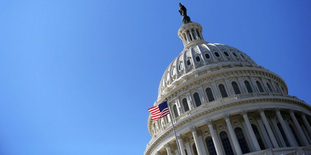 WASHINGTON, DC - FEBRUARY 12: A U.S. flag flies in front of the dome of the U.S. Capitol February 12, 2013 on Capitol Hill in