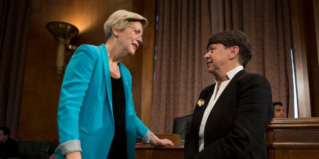 Mary Jo White, chairman of the U.S. Securities and Exchange Commission (SEC), left, talks to Senator Elizabeth Warren, a Demo