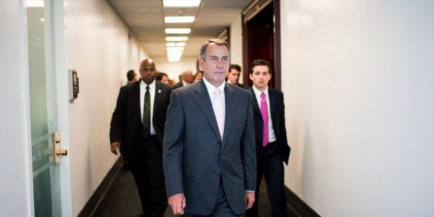 UNITED STATES - JULY 23: Speaker of the House John Boehner, R-Ohio, leaves the House Republican Conference meeting in the bas