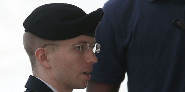 FORT MEADE, MD - AUGUST 21:  US Army Private First Class Bradley Manning is escorted by military police as he arrives for his