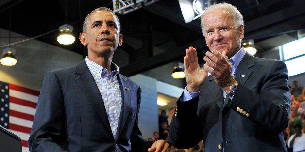 US President Barack Obama (L) and Vice President Joe Biden greet attendees after Obama spoke on college affordability at the