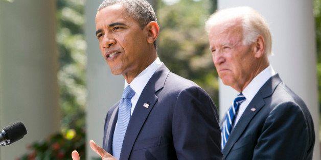 WASHINGTON, DC - AUGUST 31:  (AFP OUT) U.S. President Barack Obama (L) joined by Vice President Joe Biden delivers a statemen