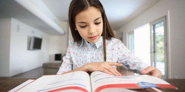 Girl (10-12) doing homework