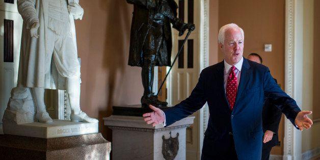 UNITED STATES - JULY 15: Sen. John Cornyn, R-Texas, walks from Senate Minority Leader McConnell's office to the Senate floor
