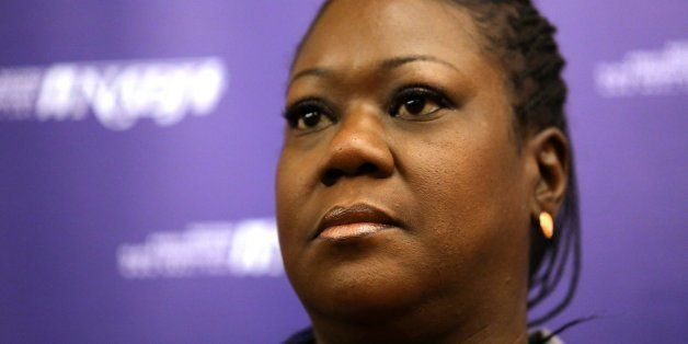The mother of Trayvon Martin, Sybrina Fulton, listens to a question during a news conference at the National Association of B