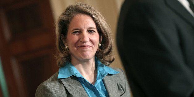 WASHINGTON, DC - MARCH 04:  Sylvia Mathews Burwell, the President of the Walmart Foundation, listens as U.S. President Barack