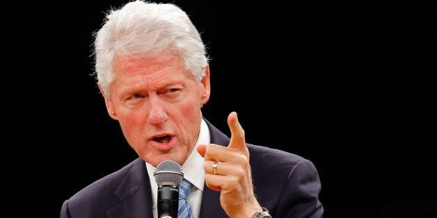 PRETORIA, SOUTH AFRICA - AUGUST 07:  Former US President and founder of the Clinton Foundation Bill Clinton reads a discussio