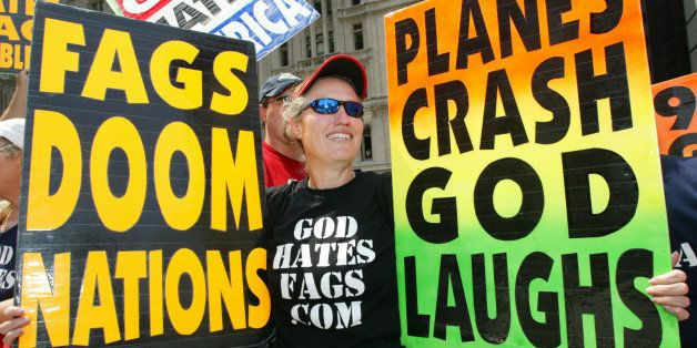 NEW YORK - JULY 4:  Shirley Phelps-Roper holds up signs as she joins fellow members of the Westboro Baptist Church, from Tope