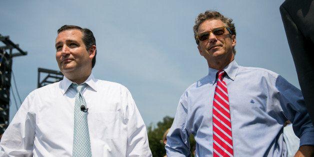WASHINGTON, DC - SEPTEMBER 10:  U.S. Sen. Ted Cruz (R-TX) (L) and Sen. Rand Paul (R-KY) wait to speak at the 'Exempt America