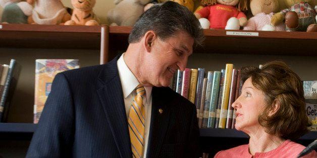 UNITED STATES - MARCH 2:  Sen. Joe Manchin, D-W.V., has a word with Sen. Kay Hagan, D-N.C., as Sen. Tom Carper, D-Del., speak