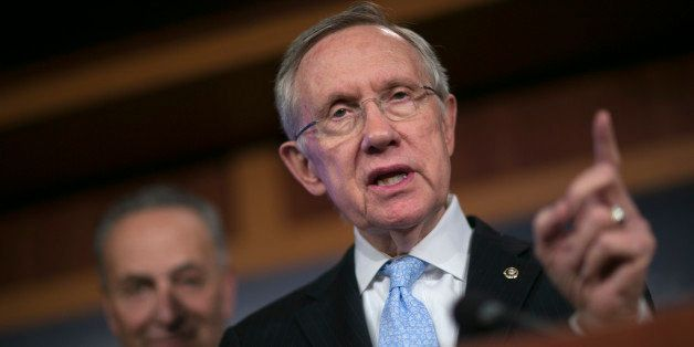 Senator Harry Reid, a Democrat from Nevada and Senate majority leader, right, speaks during a news conference with Senator Ch